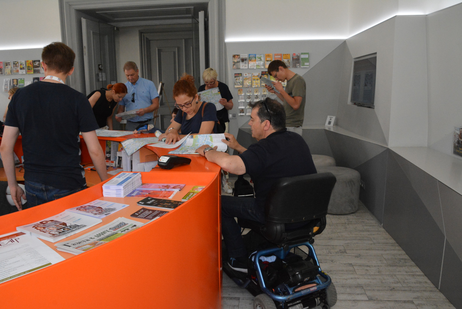 Participants on the wheelchair and with visual impairment in Lviv Tourist Information Center
