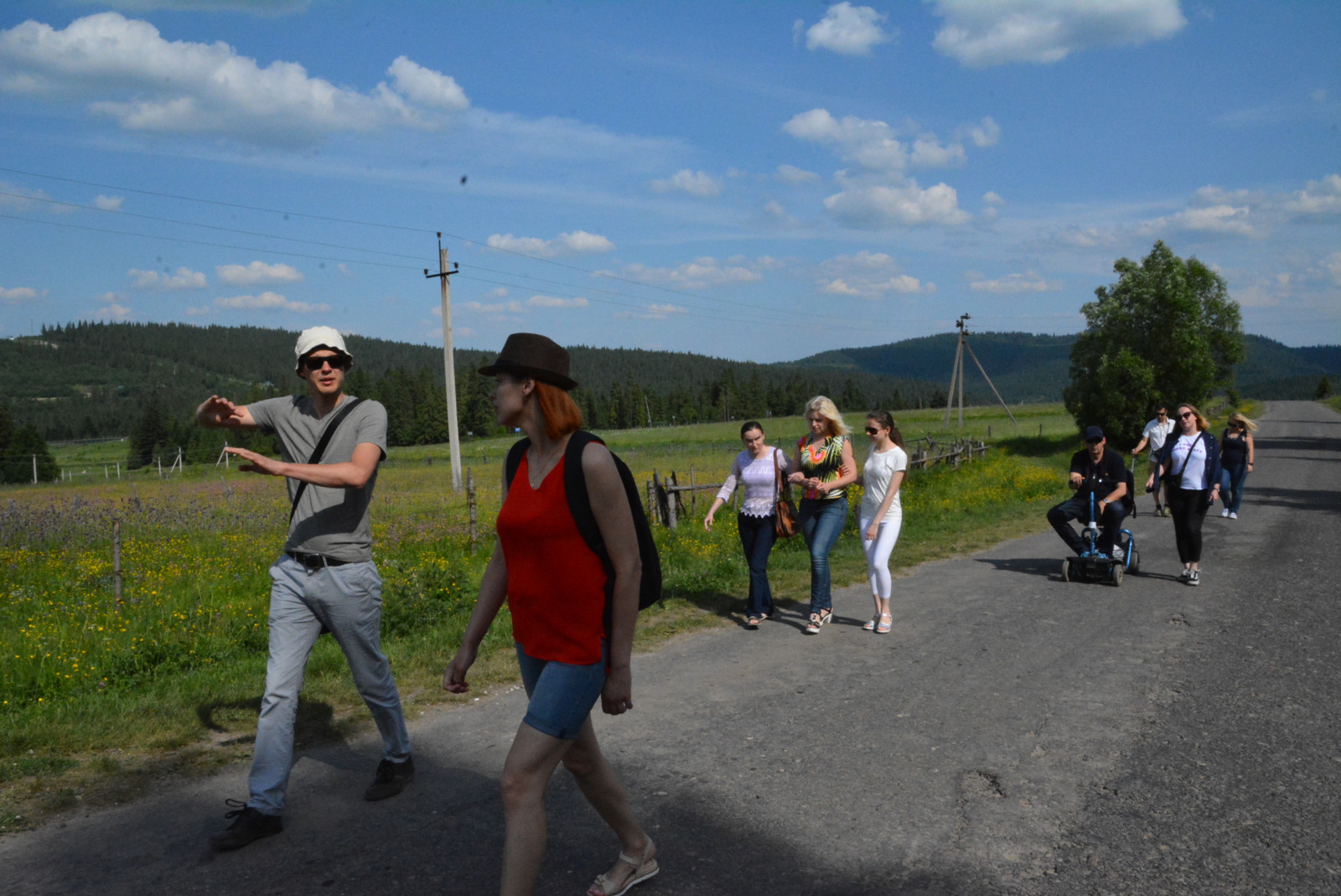 Participants are walking on the rural road